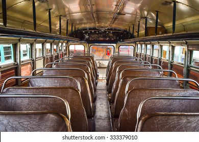 Antigua, Guatemala, May 26, 2015: Colourful chicken buses, formerly American school buses, are lined up at the main bus terminal in Antigua Guatemala, waiting for their route to begin. Interior shot.