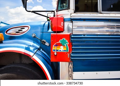 Antigua, Guatemala, May 26, 2015: Colourful chicken buses, formerly American school buses, are lined up at the main bus terminal in Antigua Guatemala, waiting for their route to begin.