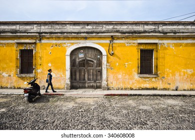 Antigua, Guatemala  May 30, 2015: Colorful colonial buildings tend to be painted yellow in Antigua, Guatemala, a UNESCO World Heritage Site founded in the 16th century. Travel background.