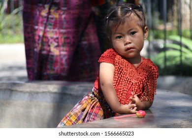 ANTIGUA, GUATEMALA - OCTOBER, 2019: The people of Guatemala, a portrait of adorable young girl.