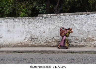 Antigua, Guatemala - October 30, 2015: A local woman walking from a local village to the centre of Antigua Guatemala, a UNESCO World Heritage Site founded in the 16th century.
