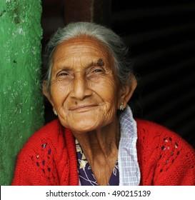 ANTIGUA, GUATEMALA - SEPTEMBER, 2016 - Guatemalan woman: An elderly Guatemalan woman sells pasty on the street in Antigua, Guatemala.