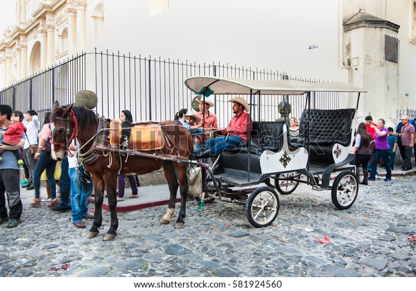 ANTIGUA, GUATEMALA-DEC 25, 2015: : Horse transportation  in the old town of Antigua, on Dec 26, 2015, Guatemala.