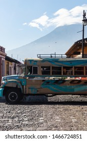 ANTIGUA, SACATEPEQUEZ/GUATEMALA - December 23, 2018: The Agua Volcano (Volcan de Agua) as seen from behind a moving bus in the UNESCO World Heritage site of Antigua, Guatemala.