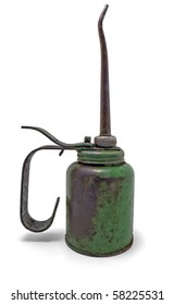 Antigue green rusty old oil can side view on white background