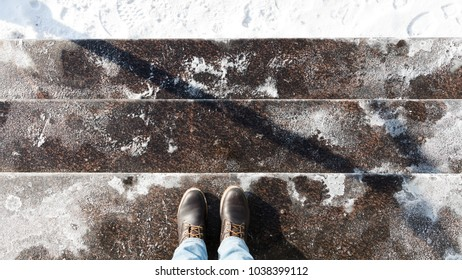 Anti-icing chemicals in winter season/ Stair is sprinkled with technical salt or salt mixtures based on it/ Reagent - technical salt will make the road safe/ Effective tool to fight ice on surfaces