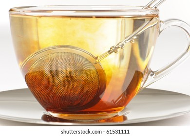 Antioxidant rich healthy herbal rooibos tea from the Western Cape region in South Africa, brewing in a cup.