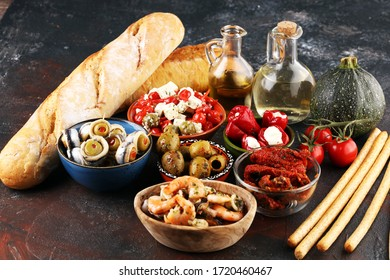 Antipasti Appetizer sweet cherry peppers stuffed with soft cheese feta, olives with oil. Seafood and anchovies with olives and dried tomatoes. Italian mediterrane