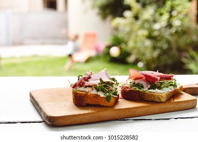 antipasti bruschetta with jamon and greens on cheese