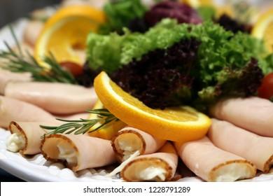 Antipasti: Cold turkey breast rolls with waldorf salad
