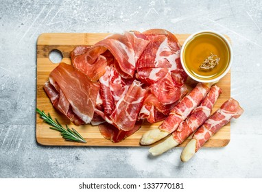 Antipasto background.The various meats. On a rustic background.