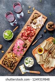 Antipasto Platter. Ham serrano, salami olive jamon dip sauces and red wine. Top view