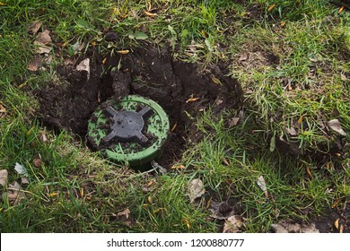 Anti-personnel mine in the ground. dig a mine. antipersonnel mine. mining. Demining. Minefield