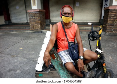 Antipolo City, Philippines - April 15, 2020: People are encouraged to wear protective face mask by the local government when going outside during the lockdown due to Covid 19 virus outbreak.