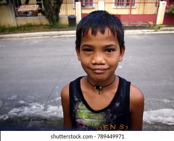 ANTIPOLO CITY, PHILIPPINES - DECEMBER 24, 2017: A boy pose and smiles for the camera.