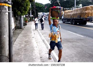Antipolo City, Philippines – December 5, 2019: Street vendor sells Balut or steamed duck egg and Chicharon or fried pork skin.