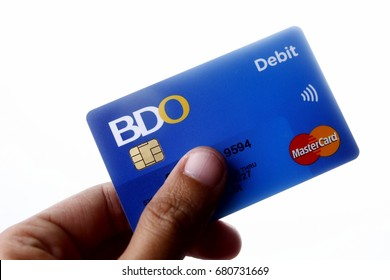 ANTIPOLO CITY, PHILIPPINES - JULY 17, 2017: A hand holds a BDO Debit Mastercard.