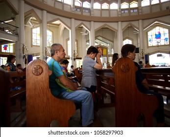 ANTIPOLO CITY, PHILIPPINES - MARCH 26, 2018: Catholic devotees pray inside Antipolo Cathedral or Our Lady of Peace and Safe Voyage.