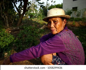 ANTIPOLO CITY, PHILIPPINES - MARCH 28, 2018: A farmer takes a break and pose for the camera.