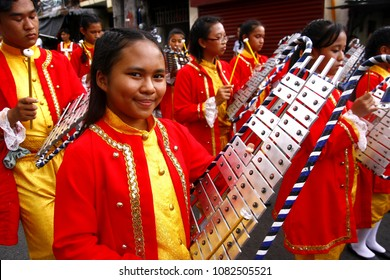 ANTIPOLO CITY, PHILIPPINES - MAY 1, 2018: Members of a marching band play their instruments at a parade during the Sumakah Festival in Antipolo City.