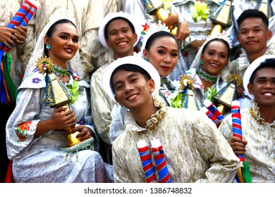 ANTIPOLO CITY, PHILIPPINES - MAY 1, 2019: Parade participants in their colorful costumes march and dance in the street during the Sumakah Festival in Antipolo City.