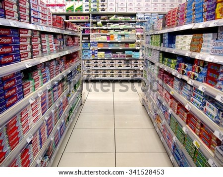 ANTIPOLO CITY, PHILIPPINES - NOVEMBER 19, 2015: Oral care products and table napkins on the shelves of a grocery store in Antipolo City, Philippines