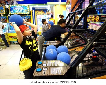 ANTIPOLO CITY, PHILIPPINES - OCTOBER 8, 2017: Customers enjoy video games and different attractions inside an amusement arcade.