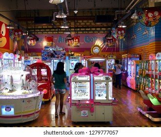 ANTIPOLO, RIZAL, PHILIPPINES - JANUARY 3, 2019: Customers of a video arcade enjoy games and attractions with their family.