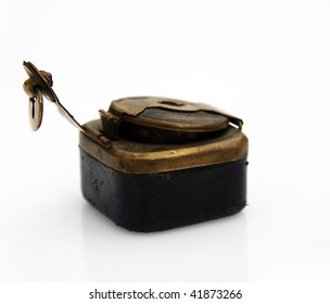 Antiquarian inkwell with the lock. It is executed in bronze and a skin.