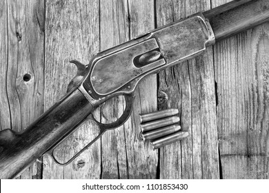 Antique 1876 lever action cowboy rifle in black and white.