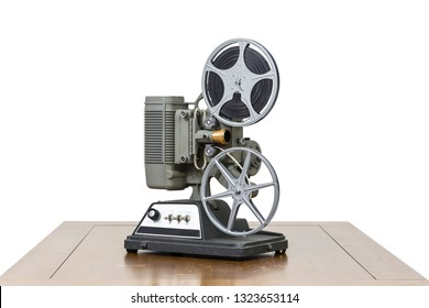 Antique 8mm home movie projector on wood table isolated on white.