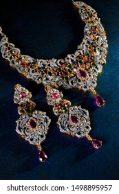 Antique Asian wedding Gold necklace set in Ruby stones isolated