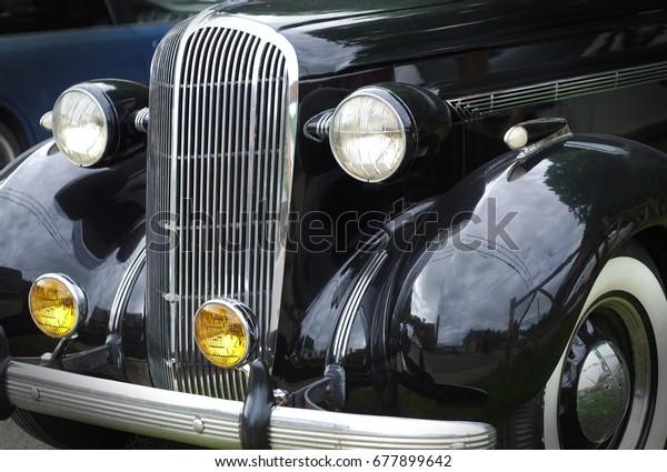 antique automobile black paint chrome shiny retro vintage car front