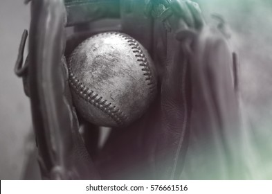 Antique baseball glove and ball background. Graphic image for coach, athlete or sports fan.