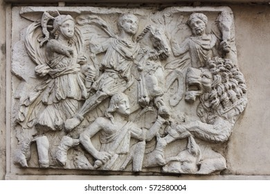 Antique bas-relief depicting a scene of war in a park in Rome