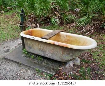 An Antique Bathtub and Hand Pump