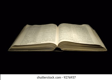 Antique Bible on a black background