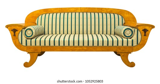 Antique Biedermeier sofa isolated with authentic fabricand woor carving