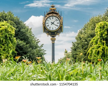 Antique big clock with four sides in the middle of Cismigiu park in Bucharest, Romania