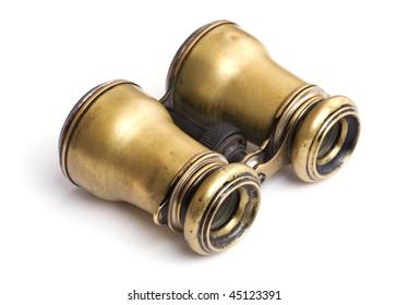 Antique binoculars on white background
