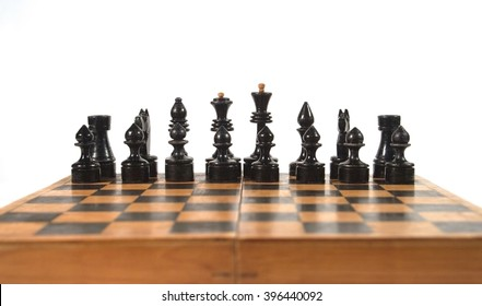 Antique black chess figures on the chessboard (isolated on white, with copy space for your text), shallow DOF with selective focus on the figures