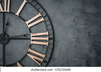 Antique black antique metal clock with Roman numerals