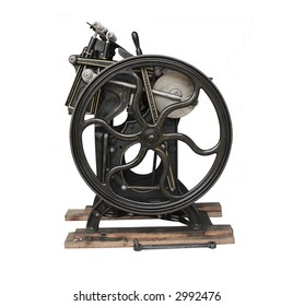 antique black printing press with gold trim, isolated on white