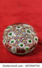 A antique blown glass flower design paperweight