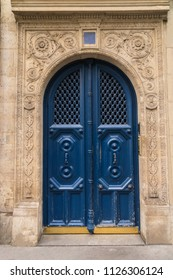 An antique blue door on the streets of Paris France.