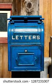 Antique Blue Letter Box on the Telegraph made of wood.