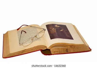 Antique book with reading glasses