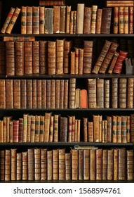 antique books on bookshelf in a library