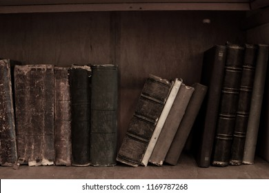 Antique books on bookshelf. Old leather bound vintage books in a row