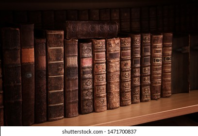 antique books on old wooden shelf.